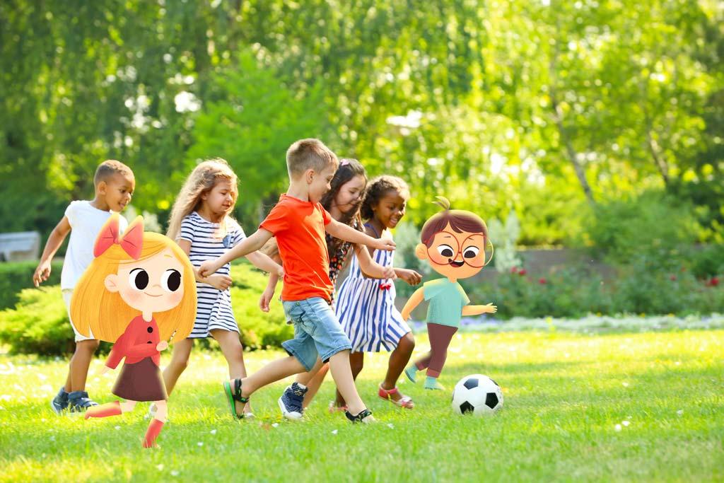 Cute little children playing football outdoors